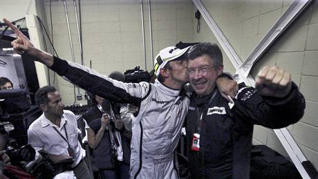 Jenson Button (vlevo) a Ross Brawn