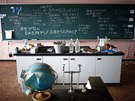 Messages of support are written on a blackboard in a science class of primary...