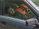 Migrant workers sleep in a car in the village of Krasnaya Polyana, a venue for...