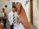 Young Palestinian bride Tala Soboh (2nd R), 14, and her groom Ahmed, 15, leave...