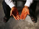 Young Palestinian groom Ahmed Soboh, 15, shows traditional henna designs on his...