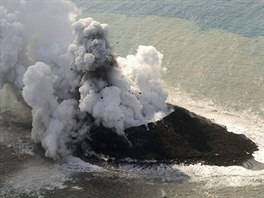 Smoke from an erupting undersea volcano forms a new island off the coast of...