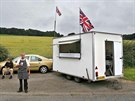 Danny, 51, poses for a photograph next to his snack trailer along the A69 near...
