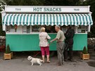People wait outside a snack van along the A683 near High Casterton, northern...
