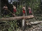 Munduruku Indian warriors stand over an area of jungle cleared by wildcat gold...