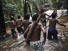 Munduruku Indian warriors approach a gold mine as they search for illegal gold...