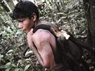 A Munduruku Indian warrior carries a monkey he hunted for food during a search...
