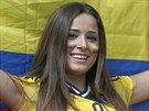 A Colombian supporter smiles as she waits for the start of the group C World...