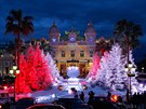 People gather in front of Christmas decorations outside the Casino in  Monaco,...