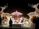 People have photos taken in a Christmas decoration on a street in Warsaw,...