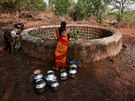A resident fetches water from a well outside Denganmal village, Maharashtra,...