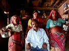 Sakharam Bhagat, 66, poses with his wives, Sakhri, Tuki and Bhaagi (L to R)...