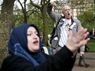 A speaker (back) addresses a crowd next to a heckler at Speakers' Corner in...