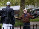 A man gestures during a speech by Muslim speaker Osman (C) at Speakers' Corner...