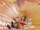 China's Li Ling lays on the mat after an attempt in women's pole...