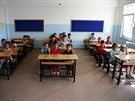 Syrian refugee students in second grade wait for the start of their first...