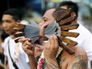 A devotee of the Chinese Samkong Shrine walks with knives pierced through his...