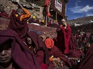 Tibetan Buddhist monks pray at Buddhist laymen lodge during the Utmost Bliss...