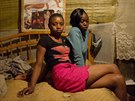 Sex workers Alice, 20 (L) and Claire 17, pose for a photograph as Aliceâ??s...