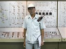 Thongdee Saenghow, a 62-year-old production supervisor, poses for a portrait...