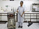 Darunee Kamwong, a 72-year-old cleaner, poses for a portrait while working in...