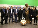 Britain's Prince William and Proince Harry pose with actors and director during a tour of the Star Wars sets at Pinewood studios in Iver Heath, west of London