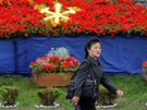 A woman passes decoration placed near April 25 House of Culture, the venue of the Workers' Party of Korea (WPK) congress in Pyongyang