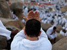 Muslim pilgrim prays on Mount Mercy on the plains of Arafat during the annual...