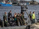Egyptian coast guard and rescue workers bring ashore bodies recovered from a Europe-bound boat that capsized off Egypt's Mediterranean coast, in Roset ...