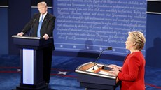 Republican U.S. presidential nominee Trump listens as Democratic U.S....