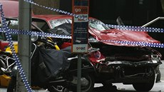 The wreckage of a car is seen as police cordoned off Bourke Street mall, after...