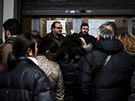 People line up to apply for a social benefit from the Directorate of  Social Welfare and Health of the Municipality of Athens, Greece,  February 14, 2017.