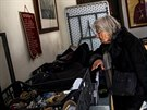 Content: An elderly woman searches through donated clothes at a soup kitchen  run by the Orthodox church in Athens, Greece, February 15, 2017.