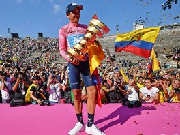 Ecuador Richard Carapaz poses with a trophy for the winner of Giro Cycling ...