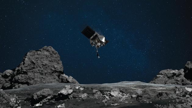 Umělcova představa odběru vzorků z asteroidu Bennu