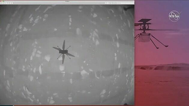 Snímek z navigační kamerky vrtulníčku Ingenuity pořízenı při jeho prvním letu na Marsu.