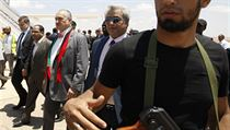 Foreign Minister Karel Schwarzenberg (wearing a scarf comprised of the Libyan national colors) arrives on a fact finding and humanitarian mission to the rebels