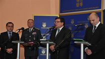 Gen. Vlastimil Picek (center left) and Defense Minister Alexandr Vondra (to his right) at Tuesday's press conference