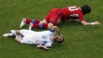 Greece's Giorgos Karagounis cries in pain after being kicked on the face by Czech Republic's Tomáš Rosický during Tuesday's match