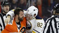 Philadelphia Flyers' Radko Gudas (3) and Buffalo Sabres' Marcus Foligno (82) fight during the second period of an NHL hockey game, Thursday, Feb. 11,  ...