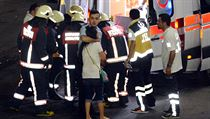 Paramedics help injured outside Turkey's largest airport, Istanbul Ataturk following a blast
