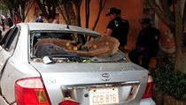 A broken car near the headquarters of private security company Prosegur is pictured in Ciudad del Este