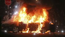 A car burns after petrol bombs were thrown at police in Creggan, Londonderry,...