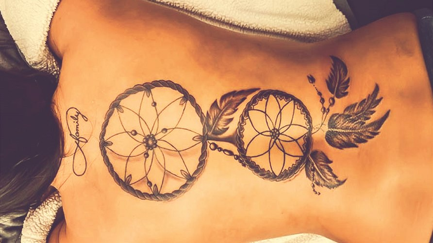 KHO63659f_25woman_with_dreamcatcher_tattoo_on_.jpg