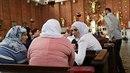 Muslimky v evangelickém kostele na náměstí Jiřího z Poděbrad.