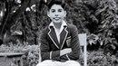 Tenhle kluk s obřím předkusem je Freddie Mercury!