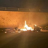 This photo released by the Iraqi Prime Minister Press Office shows a burning...