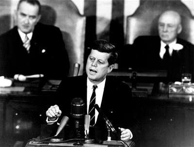 President Kennedy served in the U. S. Navy during WW II and thus drew from his wartime experience