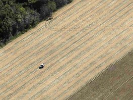 A tractor works on a wheat plantation on land that used to be virgin Amazon...