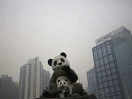 A combination picture shows statues of pandas on a sunny day (L) and...